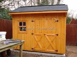 board and baton quaker with cedartone stain black shingles with ridgevent 20x20 wooden window