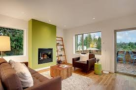 stylish living room with a green accent wall design limelite development