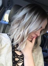 grey blonde highlights on dark hair for a dimensional look