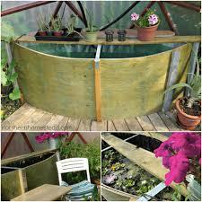diy greenhouse watering system update geodome greenhouse water tank northern homestead
