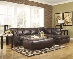 area rug wooden floor interior ottoman recliner l shaped sofa square arm brown leather modern sectional couch with chaise and wood legs chair side table