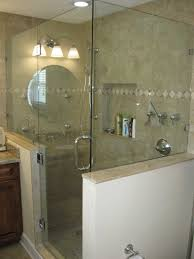 frameless shower door hinged off knee wall panel