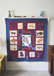DIY} How to Hang a Quilt | Shelves and Command hooks & How to hang a quilt on the wall...love the shelf on top Adamdwight.com