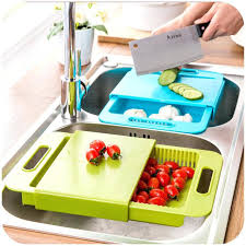 kitchen sink cutting board plastic drain basket vegetables cut with one washing rack over