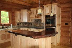 natural wood countertops with natural live edge featured on rustic knotty hickory cabinets created by kelly maxwell