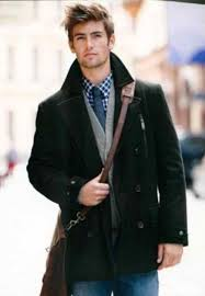 a black pea coat looks especially elegant when paired with blue jeans