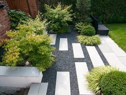 installing a walkway of pavers and pebbles