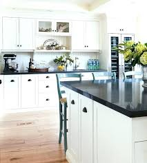 cup pulls black cup pulls two tone black and white kitchen features off white cabinets with