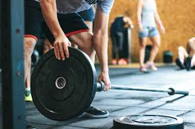 Image result for person struggling to lift weights