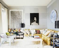 View in gallery A black lampshade stands out in the living room with an  all-white backdrop