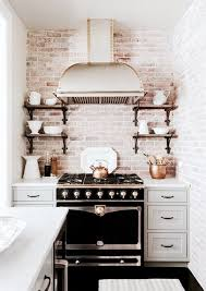 Gold And Black Kitchen With Exposed Brick Walls