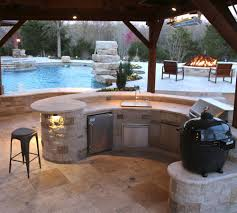 outdoor kitchen and entertaining space in north dallas outdoor living room by prestige pools