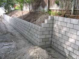 Cinder Block Retaining Wall-leave it plain, so the kids can make murals with