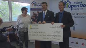 saskatchewan immigration jobs skills and training minister jeremy harrison presented a cheque to the regina open door society on thursday