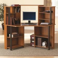multi level computer desk with wood desk and shelf and carpets