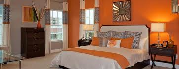 Contemporary Master Bedroom With Orange Accent Wall And Carpet  Flooring.Source: Zillow Digs