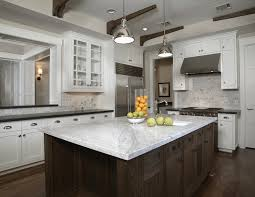 black kitchen cabinets with white marble countertops. Vintage Kitchen Design With White Carrera Marble Countertops, Stainless Steel Range Hood, And Metal Shade Pendant Lighting Black Cabinets Countertops T
