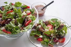 mixed green salad with strawberries.  Strawberries Mixed Greens Salad With Strawberries Feta Pecans And Red Wine Vinaigrette On Green With Strawberries