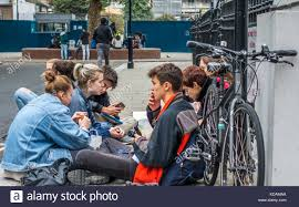 A Gathering Of Teenage College Students One Of Them Smoking A