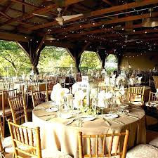 simple wedding reception ideas centerpieces for round tables vintage decorations with wooden chairs and large t