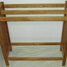 wall quilt rack mounted with swinging arms amish hanger free plans