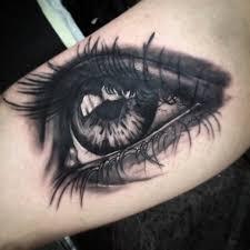 татуировка на бицепсе девушки глаз фото рисунки эскизы