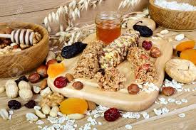 fitness bars with granola oatmeal nuts dried fruit and honey on the table