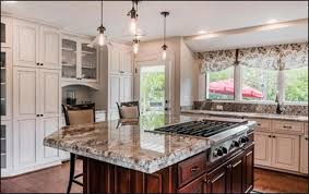 this custom kitchen uses a lot of contrast to create beautiful visual interest and depth