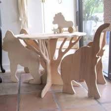 unique playroom furniture. a table shaped like tree chairs with animal profiles unique playroom furniture o