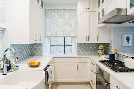 White and Blue Kitchen with Blue Fish Scale Tile Backsplash