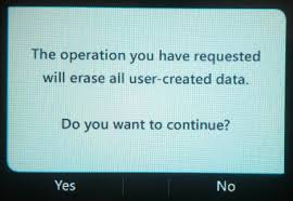 select yes to confirm the action and the device will reboot wiping the cur configuration polycom cx700