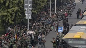 s military veterans have taken to the streets to protest hundreds of protesters in green fatigues gather outside the chinese ministry of national defense to protest