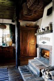kitchen fireplace in a century old cabin in poland interior design decorating ideas