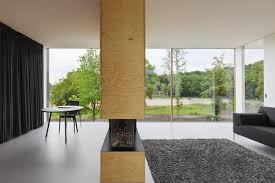 Following the design mantra of less is more, I29 Interior Architects  designed a fireplace as room divider with a minimalist, clear finished pine  plywood ...