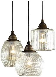 this beautifully crafted 3 light cer pendant is part of the cardington collection the classic aged bronze finish and assorted glass shades provides an