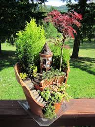 This Fairy Garden design is another wonderful way and puts broken pottery  or broken planters to