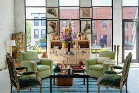 a mid century vintage rug in room shows beautiful bold colors and eclectic furniture