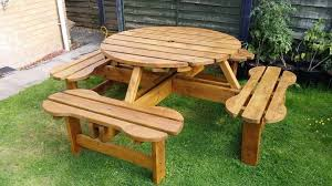 large round wooden picnic garden table with 4 benches 8 seats