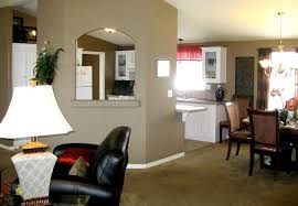 furniture for mobile homes. an open space for mobile homes with a black leather corner chair red and brown furniture
