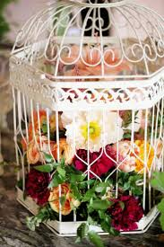 Birdcage Centerpiece with Amaryllis Tulips, Peonies, Carnation, Anemones  and Roses  Source: Floret Cadet