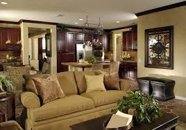 elegant living room set. lush cherry wood cabinetry throughout the kitchen area in this shared open space contrast with beige elegant living room set l