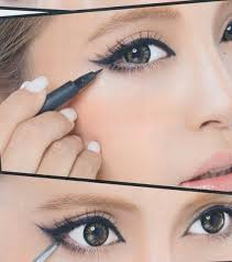 only line the outer half of your lower lid when lining your lower lid definitely wing your eyeliner to lift the eyes on the too also you might see a lot