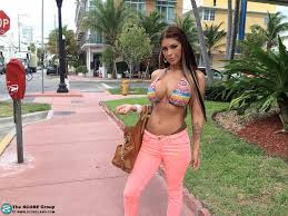 Busty babe Brook Ultra wearing a Bikini in Public 1 of 2