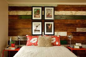gorgeous beach style bedroom with a unique reclaimed wood accent wall design garrison hullinger