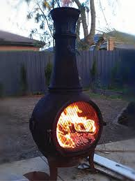 chimineas are self contained outdoor fires used for warmth they are often made of clay or metal and use wood or charcoal as fuel