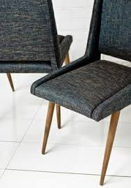 for the mid century modern home these dining chairs are the perfect accent for your dining room upholstered in a textured woven linen in navy or taupe