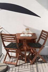 ikea applaro table and two folding chairs allow you to adjust the table size according to
