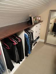 attic closet with hangers and drawers