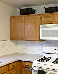 benjamin moore classic gray in a kitchen with oak wood cabinets white subway tile and