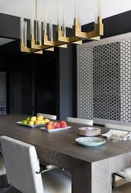 moody modern dining room with amazing gold light fixture love the idea of black walls design by laura singleton impressive fixtures ideas u50 impressive